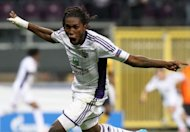 Anderlecht's Dieumerci Mbokani celebrates after scoring during their Champions League playoff second-leg football match against Limassol, in Anderlecht. Mbokani set Anderlecht on their way to a 2-0 home win over Cypriots AEK Limassol that enabled the Belgians to overturn a 2-1 deficit from last week's first leg