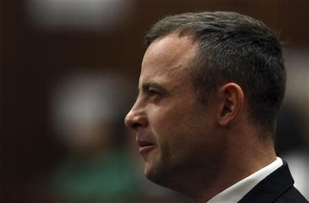 South African Olympic and Paralympic athlete Pistorius sits in the dock during his murder trial in the North Gauteng High Court in Pretoria