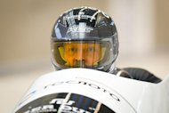 Russia's Alexander Zubkov takes part in a Men's Bobsleigh training run at the Sanki Sliding Centre, one of the 2014 Winter Olympics venues, at Rzhanaya Polyana, 60 km northeast of the Black Sea city of Sochi, on February 14, 2013