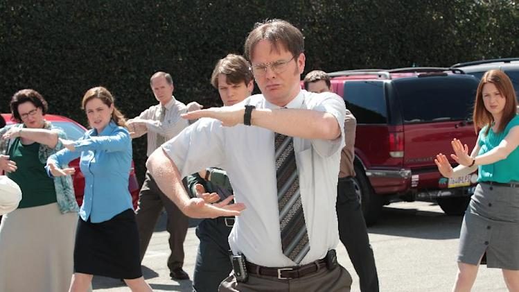 "This publicity image released by NBC shows the cast of ""The Office,"" from left, Phyllis Smith as Phyllis Vance, Jenna Fischer as Pam Beesly Halpert, Jake Lacy as Pete, Rainn Wilson as Dwight Schrute, Ellie Kemper as Erin Hannon, right, in a scene from the series finale, airing Thursday, May 16, 2013 on NBC. (AP Photo/NBC, Chris Haston)"