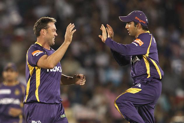 Jacques Kallis of Kolkata Knight Riders is congratulated by Kolkata Knight Riders captain Gautam Gambhir for getting Virender Sehwag of Delhi Daredevils wicket during match 44 of the Pepsi Indian Prem