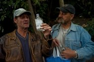 Two men drink alcohol from bottles on a street in Prague on September 12. Local spirits producers were taken aback by a ban on Czech spirits imports declared on Tuesday by neighbouring Slovakia, which buys alcohol worth over 600 million koruna every year, according to the Lidove noviny broadsheet