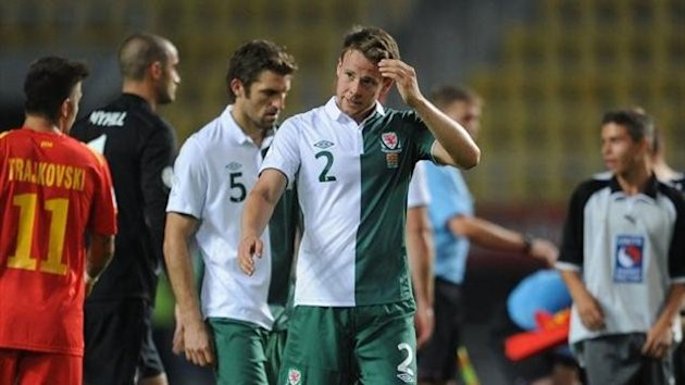Wales' Sam Ricketts (left) and Chris Gunter (right) stand dejected after the World Cup Qualifying, Group A match at the Phillip II Arena, Skopje, Macedonia.