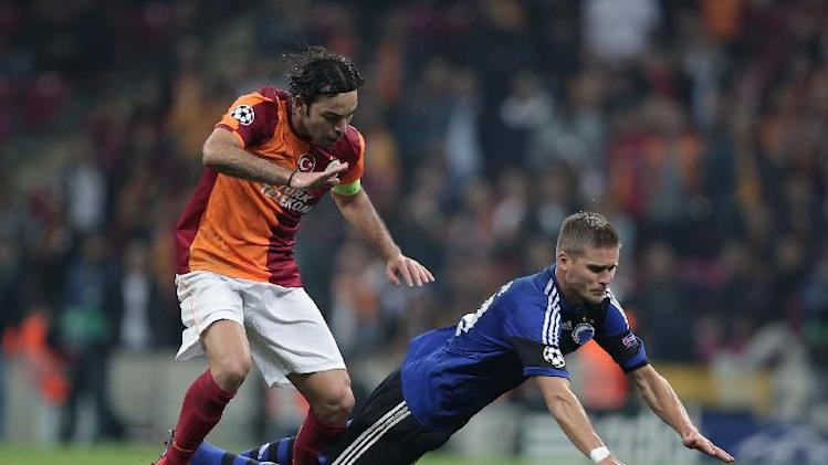 Galatasaray's Selcuk Inan, left, and Rurik Gislason of FC Copenhagen fight for the ball during their Champions League Group B soccer match in Istanbul, Turkey, Wednesday, Oct. 23, 2013. (AP Photo)