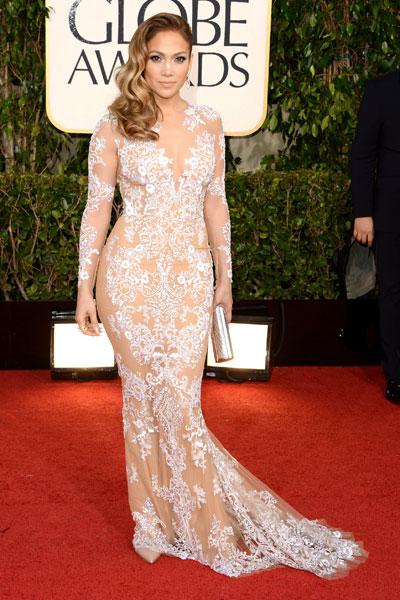 Jennifer Lopez: This is the nude dress done right! JLo rocks a sheer look with delicate white embroidery that screams sexy chic. But what we really want to see is whether the former fiance of Ben Affleck will run into the 'Argo' director with his wife Jennifer Garner. (Photo by Jason Merritt/Getty Images)
