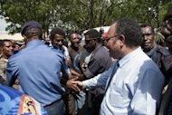 Papua New Guinea police hold back protesters as Peter O'Neill greets (R) supporters in 2011. Papua New Guinea police Monday charged a second top judge with sedition, following a supreme court ruling that Prime Minister Peter O'Neill's rise to power was unlawful