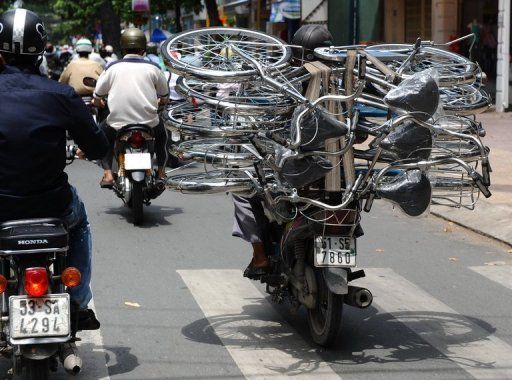 This file photo shows a man transporting bicycles in Ho Chi Minh City. Vietnamese inflation picked up to the fastest pace in six months in November, according to official data, adding to the economic challenges facing the country's Communist rulers.
