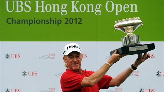 Miguel Angel Jiminez of Spain poses with the trophy after winning the UBS Hong Kong Open at the Hong Kong Golf Club