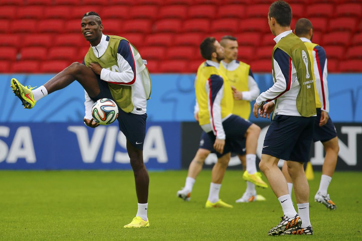 France's national soccer team player Pogba passes the ball through his legs during his team's final practice at the Beira-Rio stadium in Porto...
