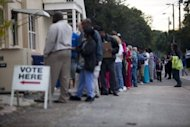 Lines of voters wait to cast their ballots as the polls open on November 6, in St. Petersburg, Florida. US President Barack Obama's top aide in Florida said Democrats have won the vote in the officially undeclared Sunshine State, where officials are under fire for mishandling the ballot