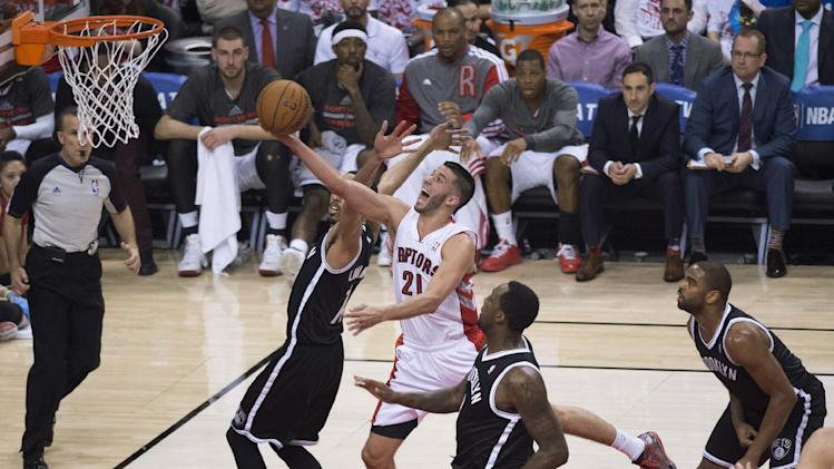 Toronto Raptors' Greivis Vasquez drives through the Brooklyn Nets defense during the first half of Game 1 of an opening-round NBA basketball playoff series, in Toronto on Saturday, April 19, 2014