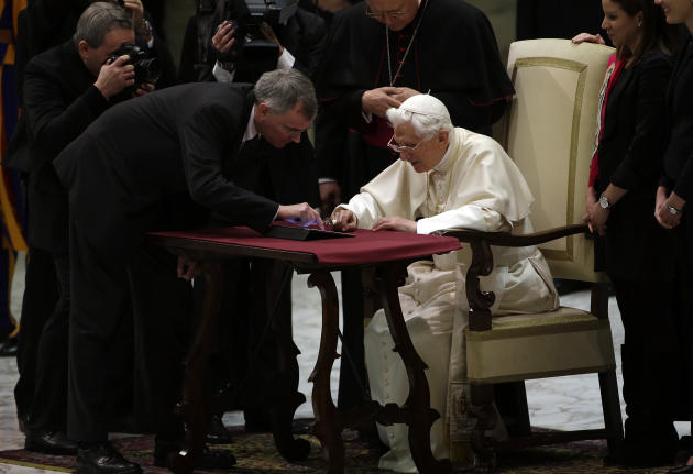 Pope Benedict XVI pushes a button on a tablet at the Vatican, Wednesday, Dec. 12, 2012. In perhaps the most drawn out Twitter launch ever, Pope Benedict XVI pushed the button on a tablet brought to hi