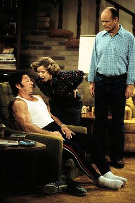 "When Bob (Don Stark, L) stays with the Formans, he drives Kitty (Debra Jo Rupp, C) and Red (Kurtwood Smith, R) nuts on the ""I Love Cake"" episode of Fox's That 70s Show"