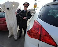 Police officers detain Greenpeace activists dressed as polar bears outside Norwegian oil and gas group Statoil's office in Moscow, on April 25, 2013. Greenpeace says it has deployed its icebreaker through an Arctic shipping route to protest against oil drilling in the fragile ecosystem, defying Russian authorities