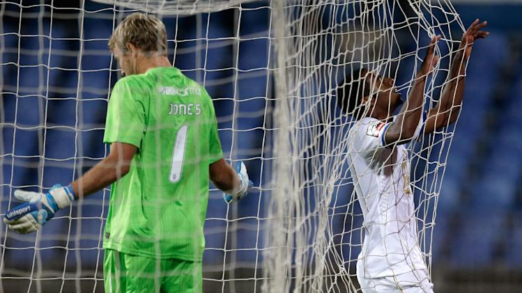 FC Porto's Ricardo Pereira, right, reacts after failing to score past Belenenses' goalkeeper Matt Jones, left, during their Portuguese league soccer match,  Saturday, Nov. 2 2013, in Lisbon.  The game ended in a 1-1 draw