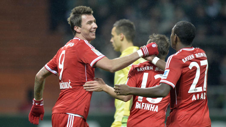 Bayern's Mario Mandzukic of Croatia, left, celebrates after scoring during the German Bundesliga soccer match between Werder Bremen and Bayern Munich in Bremen, Germany, Saturday, Dec. 7, 2013