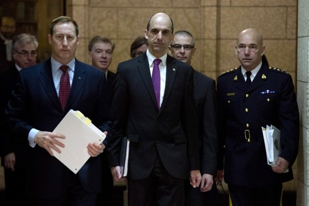 Justice Minister Peter MacKay (left), Public Safety and Emergency Preparedness Minister Steven Blaney, CSIS director Michel Coulombe and RCMP Commissioner Bob Paulson arrive at the Commons public safety committee hearing witnesses on Bill C-51, Anti-terrorism Act on Parliament Hill in Ottawa, Tuesday March 10, 2015. THE CANADIAN PRESS/Adrian Wyld