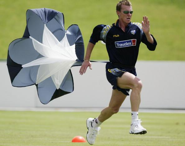 Brett Lee of Australia runs with a parachute