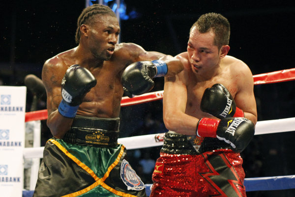 Nicholas Walters, left, battles Nonito Donaire in the second round during a WBA featherweight title boxing fight, Saturday, Oct. 18, 2014, in Carson, Calif. Walters won in the sixth round. (AP Photo/Alex Gallardo)