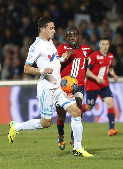Olympique Marseille's Thauvin challenges Mavuba of Lille during their French Ligue 1 soccer match at the Velodrome Stadium in Marseille