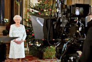 Queen Elizabeth II records her Christmas message to the Commonwealth which is to be broadcast in 3D for the first time, at Buckingham Palace in London on December 23, 2012. She will pay tribute to the London 2012 athletes in her annual Christmas message to the Commonwealth, saying they had inspired the world and drawn people in to the excitement and drama