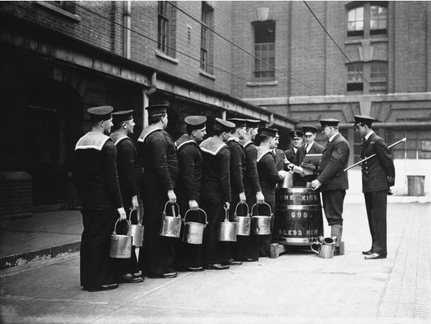 Sailors are served their rum ration