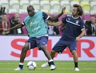 Italian forward Mario Balotelli (L) vies with Italian midfielder Andrea Pirlo during a training session in Gdansk during the Euro 2012 football championships. Balotelli still needs to learn that team-work can be a weapon, according to his national team coach Cesare Prandelli