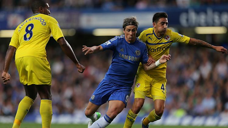 Fernando Torres, centre, scored a late winner for Chelsea against Reading
