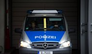 "A police car transports Luka Rocco Magnotta (unseen) from the main detention center in Berlin. The porn actor dubbed the ""Canadian Psycho"" for allegedly killing and chopping up another man has told a Berlin judge he would not challenge his extradition from Germany"