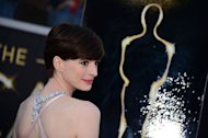 Anne Hathaway arrives on the red carpet for the Oscars on February 24, 2013 in Hollywood, California. Hathaway won for Best Supporting Actress