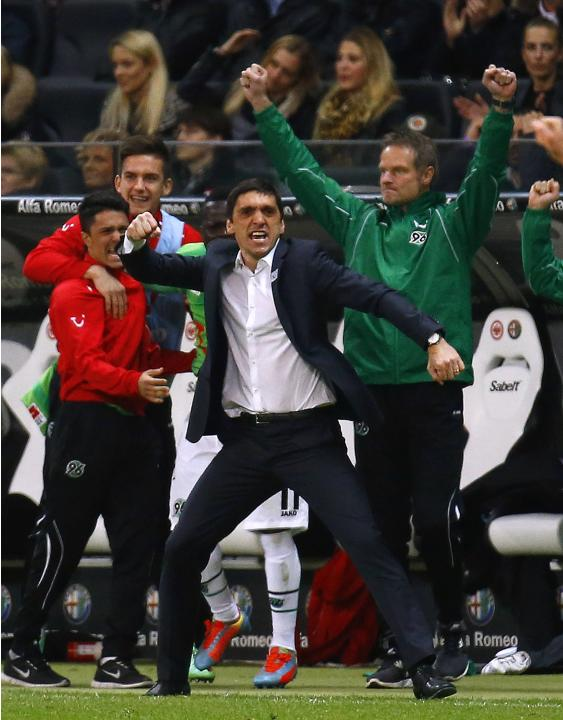 Hannover 96 coach Korkut reacts after German first division Bundesliga soccer match against Eintracht Frankfurt in Frankfurt