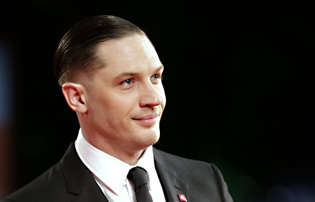 Actor Tom Hardy poses for photographers on the red carpet for the film Locke at the 70th edition of the Venice Film Festival held from Aug. 28 through Sept. 7, in Venice, Italy, Monday, Sept. 2, 2013. (AP Photo/Andrew Medichini)