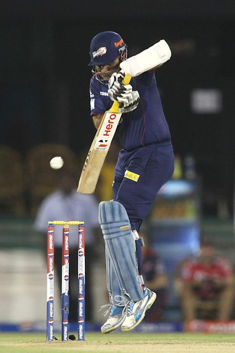 Virender Sehwag of Delhi Daredevils defends a delivery during match 44 of the Pepsi Indian Premier League between The Delhi Daredevils and the Kolkata Knight Riders held at the Chhattisgarh Internatio