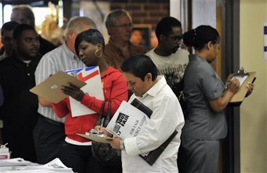 Unemployed people attend a job fair. Rockford has one of the highest unemployment rates in the nation.