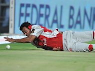 Kings XI Punjab fielder Shalabh Srivastava stops a ball during the IPL Twenty20 cricket match between Kochi Tuskers Kerala and Kings XI Punjab at the Nehru Stadium in Indore, 2011. Five domestic Indian Premier League players, including Srivastava, were suspended from cricket after a sting operation by a local TV channel highlighted alleged fixing and corruption
