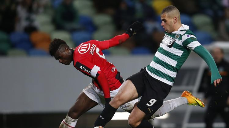 Sporting's Islam fights for the ball with Olhanense's Jander during their Portuguese premier league soccer match in Lisbon