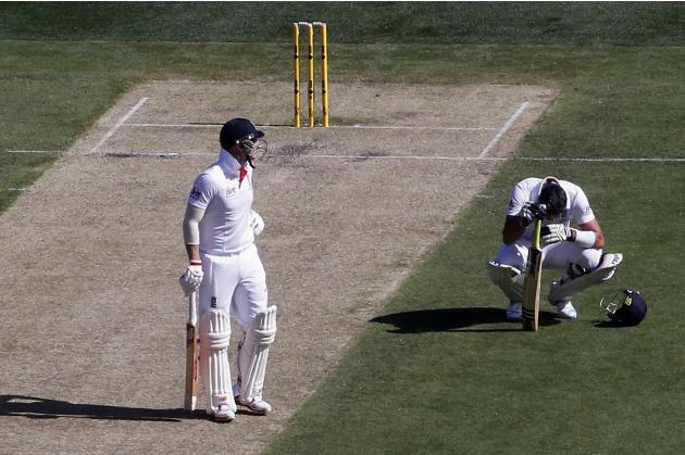 England's Stokes looks at teammate Pietersen as he reacts after, according to local media, he had swallowed a fly during the first day of the fourth Ashes cricket test against Australia at the Mel
