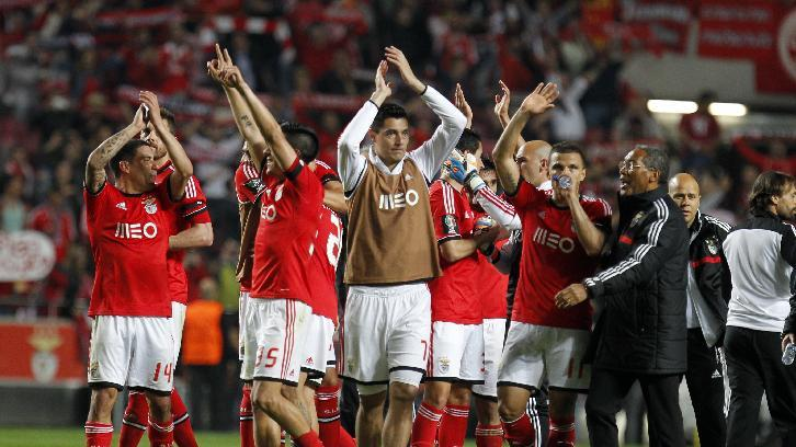Benfica's players celebrate at the end of a Portugal Cup semifinal second leg soccer match between Benfica and Porto at Benfica's Luz stadium in Lisbon, Wednesday, April 16, 2014. Benfica won 3-2 on aggregate and will play the final