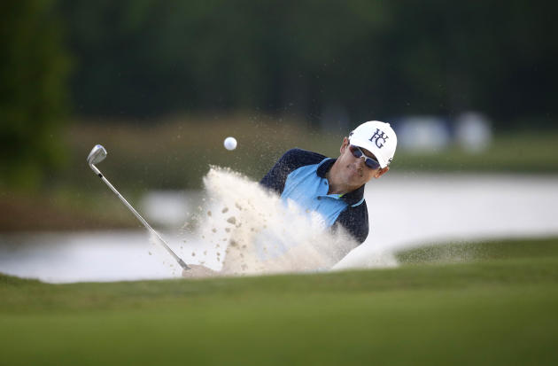Scott Langley hits out of the sand onto the 18th green during the opening round of the PGA Zurich Classic golf tournament at TPC Louisiana in Avondale, La., Thursday, April 24, 2014. (AP Photo/Gerald