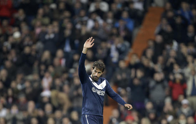 Malaga's Ruud van Nistelrooy of the Netherlands, a former Real Madrid player waves to the Real Madrid fans as he is substituted during the first leg of a round of 16 Copa del Rey soccer match agai