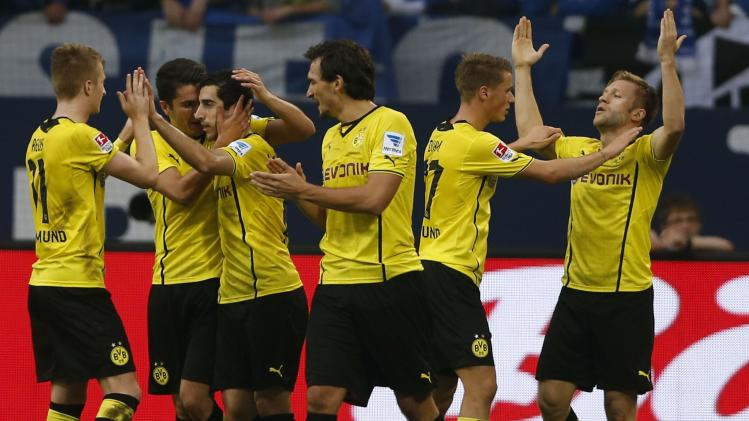 Borussia Dortmund's Blaszcykowski celebrates his goal against Schalke 04 during their German first division Bundesliga soccer match at the Schalke Arena in Gelsenkirchen
