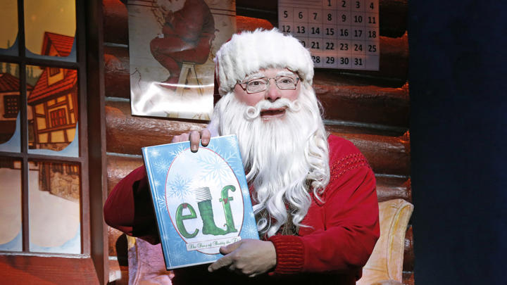 "This undated publicity photo provided by The Hartman Group shows Wayne Knight as Santa in ""Elf"" at the Al Hirschfeld Theatre in New York. (AP Photo/The Hartman Group, Joan Marcus)"