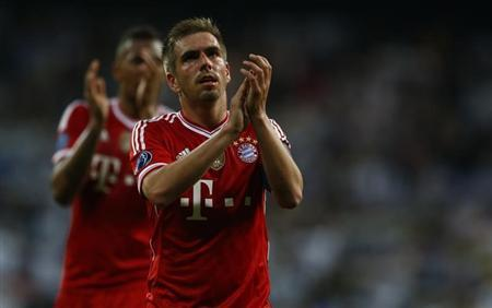 Bayern Munich's Lahm and Boateng acknowledge fans after losing to Real Madrid in Champion's League semi-final first leg soccer match in Madrid