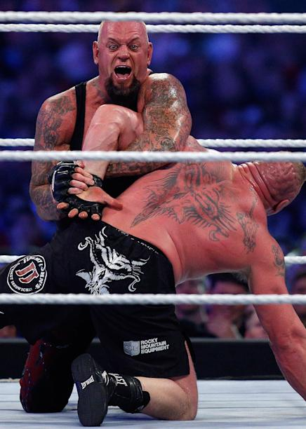 The Undertaker  top  and Brock Lesnar  bottom  compete during    Undertaker 2014 Look