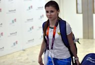 Uzbek athlete Luiza Galiulina arrives at Heathrow airport in London on July 24, three days before the start of the London Olympic Games. Galiulina has been provisionally suspended after testing positive for the banned diuretic furosemide, the International Olympic Committee (IOC) announced on Sunday