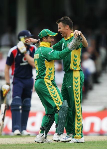 LONDON - AUGUST 29: Johan Botha (R) of South Africa celebrates the wicket of Paul Collingwood of England with team mate Mark Boucher during the Third NatWest One Day International between England and