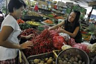 "A customer buys chilis at a market in Jakarta. ""Food is the biggest driver of inflation... August inflation is due to the Muslim fasting month and Lebaran (Eid celebrations),"" the Central Statistics Agency said"