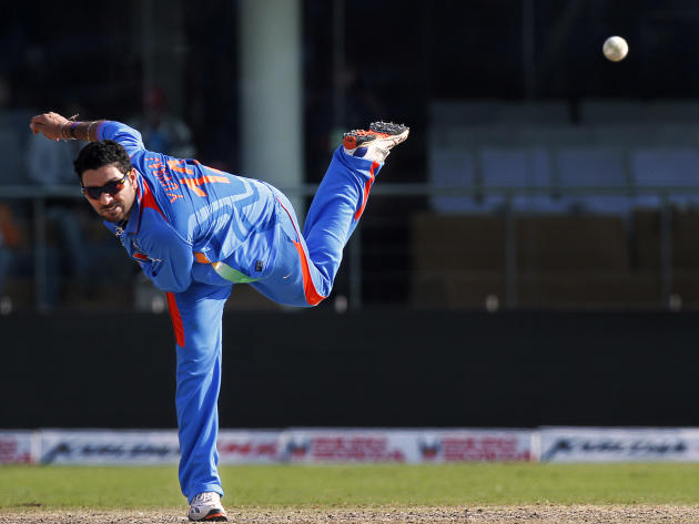 Indian Yuvraj Singh bowls during the Group B Cricket World Cup match between India and Netherlands in New Delhi, India, Wednesday, March 9, 2011. (AP Photo/Gurinder Osan)