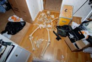 "This police handout photo made available on November 20, 2012 shows a human skeleton found in the apartment of a 37-year-old woman in Gothenburg, southern Sweden. A Swedish woman who kept human skulls and bones in her apartment was sentenced to probation and ordered to undergo psychiatric care after being convicted of ""disturbing the peace of the dead""."