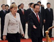 Chinese Premier Wen Jiabao (R) and German Chancellor Angela Merkel attend a welcoming ceremony at the Great Hall of the People in Beijing on August 30. Merkel is holding top-level talks on her second visit to China this year, with Europe's debt crisis taking centre stage as it begins to drag on the two global powers